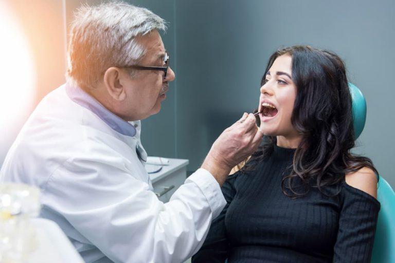 dentist-examining-female-patient-2E7MBEW (1)
