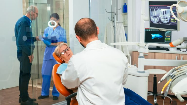 doctor-and-patient-talking-about-denture-problems-QY2MC3H (1)